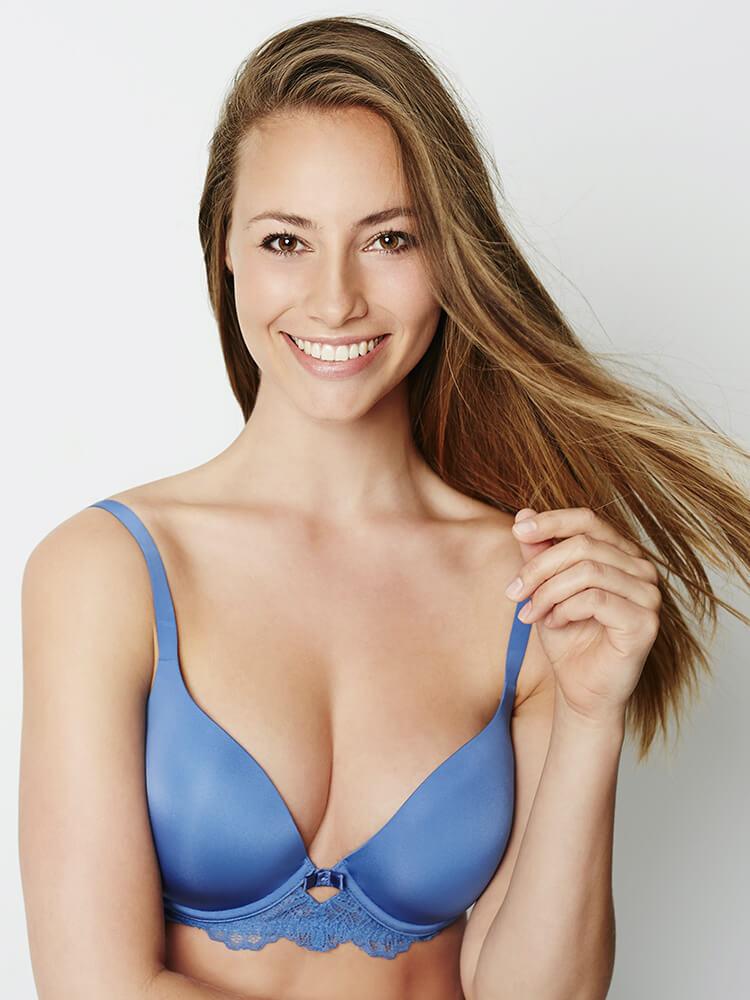 Woman in blue bra holding strap